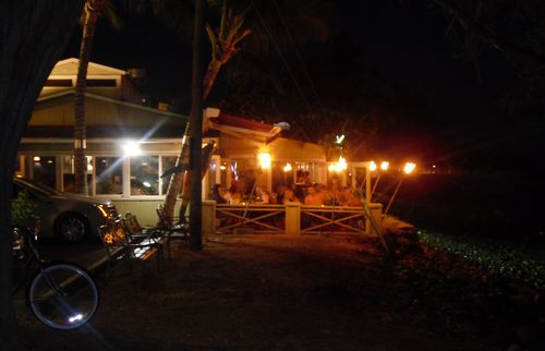 Patio with torches right on the ocean