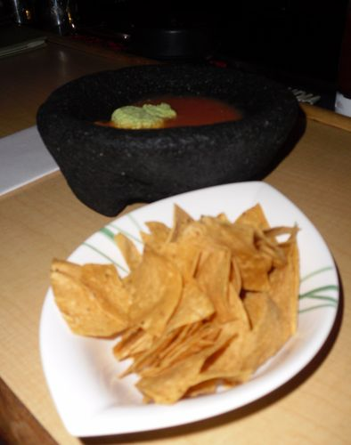 Homemade chips & edamame dip in a volcanic bowl